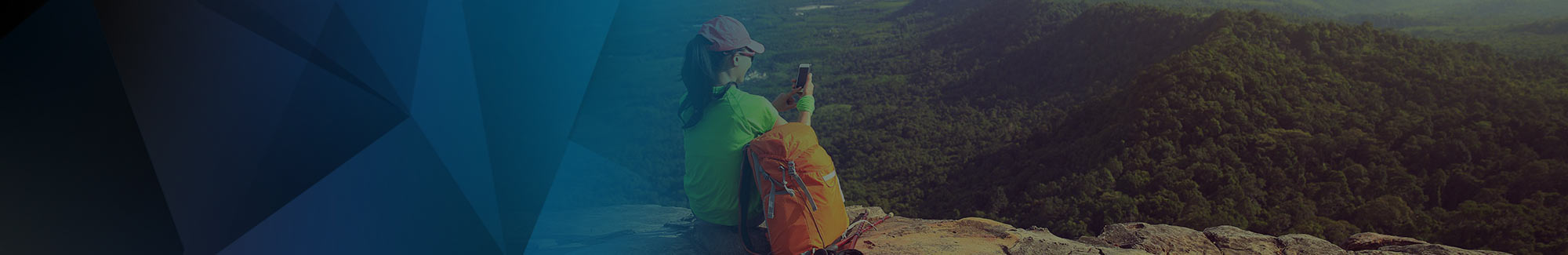 Hiker on a mountain using her smartphone